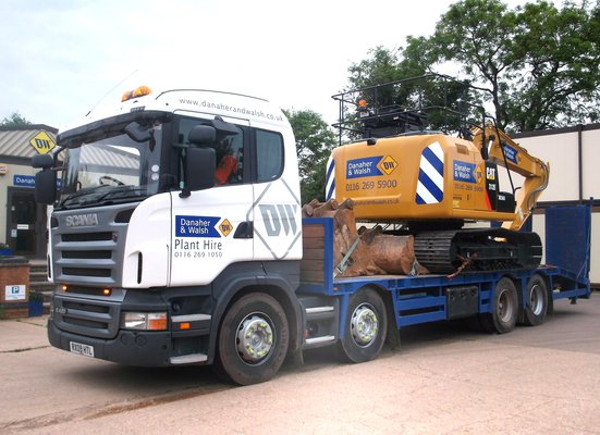 Danaher & Walsh Plant hire beavertail transporter lorry carrying a Caterpillar excavator.